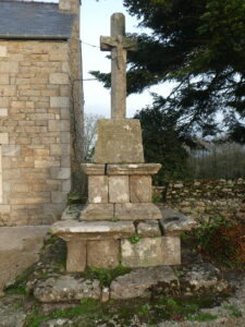 A stone cross  beside the church of the 7 Saints, Le Vieux Marche, Brittany
