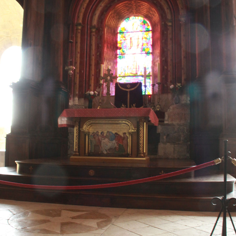 Cross before the altar in the St Sauveur Basilica